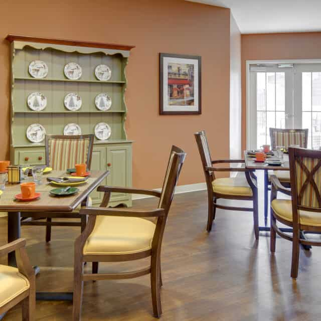 A photo of the Compass Memory Support Neighborhood dining room at Farmington Station